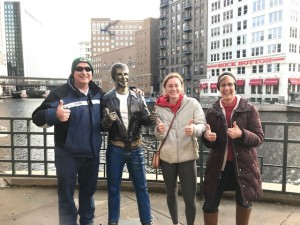 The Bronze Fonz is a popular tourist attraction along Milwaukee's RiverWalk and is beloved by multiple generations.  Denis, Emily, and Terri Dougherty enjoy posing with the Fonz.
